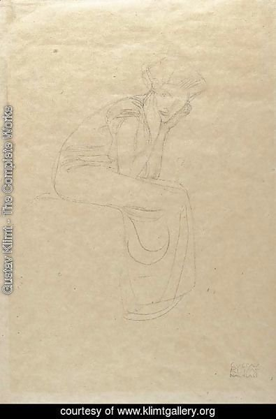 Seated woman holding her head in her hands